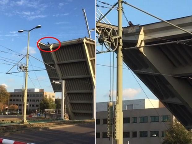 Homem ficou agarrado a ponte levadiça sobre canal na Holanda (Foto: Reprodução/YouTube/ Fred Berk)