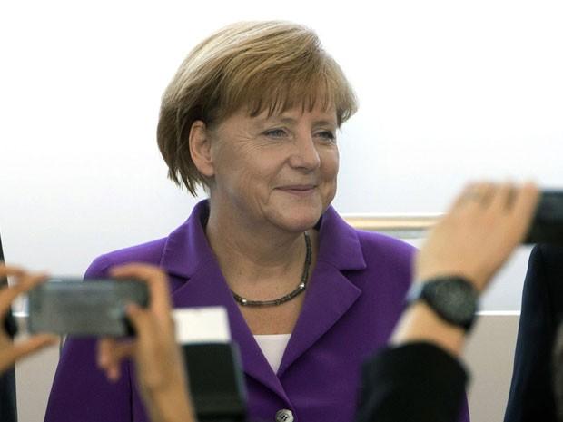 Angela Merkel vai ver a Alemanha jogar a final da Copa no Maracanã (Foto: Ng Han Guan/AP)