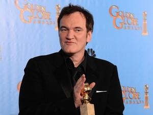 Cineasta Quentin Tarantino levou o prêmio de melhor roteiro original por 'Django livre' no Globo de Ouro 2013 neste domingo (13) (Foto: Robyn Beck/AFP)