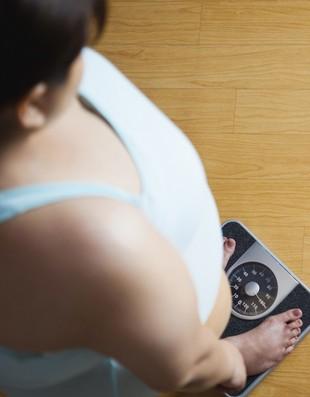 euatleta obesidade balança obesa mulher (Foto: Getty Images)