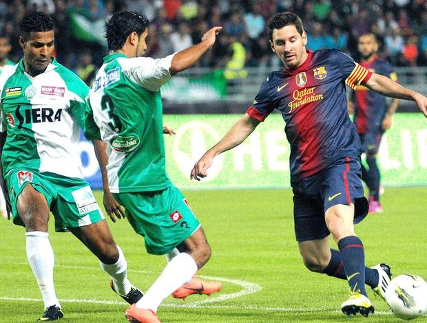 Messi na partida do Barcelona contra o Marrocos (Foto: Reuters)