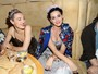 Katy Perry usa flores na cabea para ir a festa