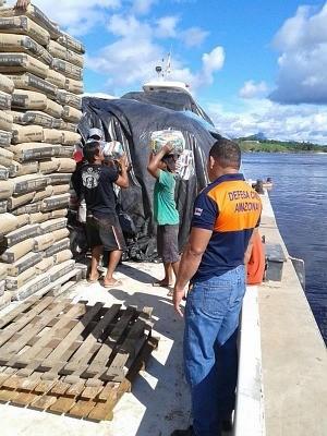 Famílias receberam cestas básicas no último fim de semana (Foto: Divulgação/Defesa Civil)