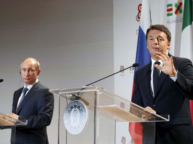 O presidente russo Vladimir Putin e o premiê italiano Matteo Renzi se encontram nesta quarta-feira (10) em Milão (Foto: REUTERS/Alessandro Garofalo)