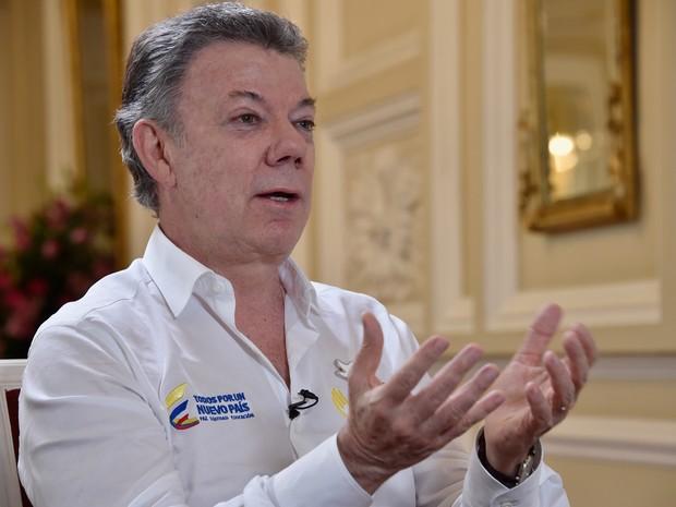 Juan Manuel Santos diz estar convencido de que sempre é melhor uma paz imperfeita que uma guerra perfeita (Foto: Guillermo Legaria/AFP)