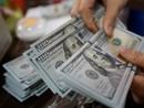 Dólar fecha semana acima de R$ 3,60 (Reuters)