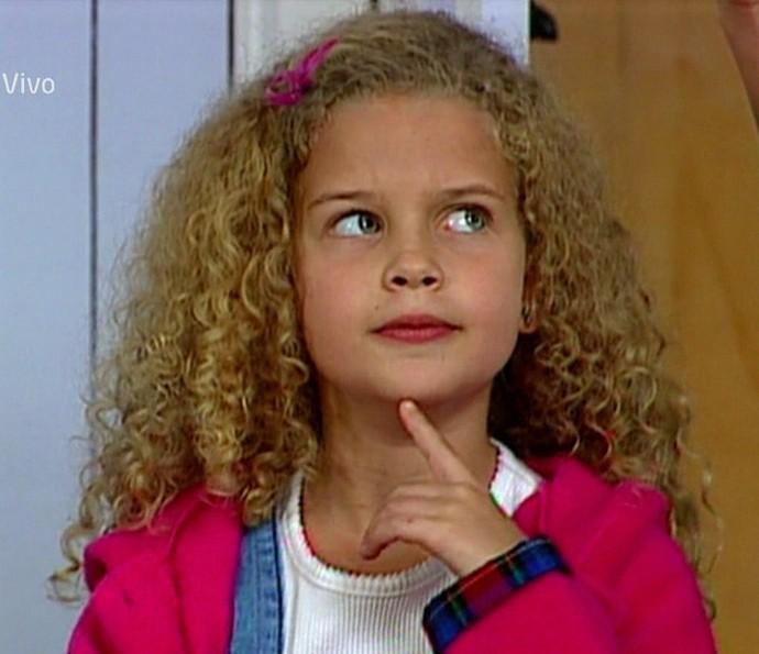 Os longos cabelos cacheados eram a marca registrada de Debby (Foto: TV Globo)