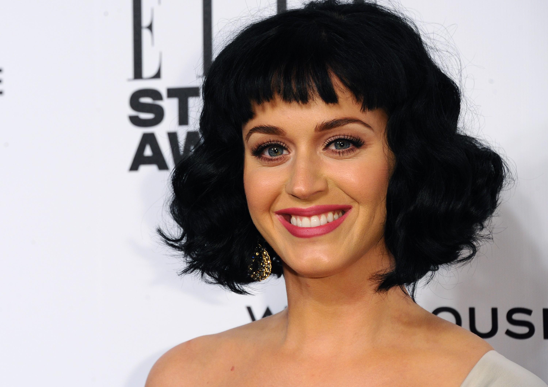 """A rainha dos katycats abriu seu romance cheio de reviravoltas que terminou em divórcio em julho de 2013 para Vogue. """"Não ouço novidades de Russell Brand desde que me enviou uma mensagem dizendo que estava se divorciando de mim em 31 de dezembro de 2011"""", contou Katy Perry. (Foto: Getty Images)"""