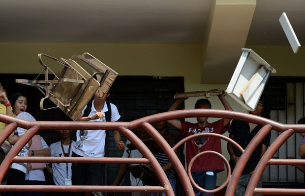 Revolta foi motivada pelo suicídio de uma jovem que foi obrigada a deixar os estudos porque não conseguiu pagar as mensalidades (Foto: Noel Celis/AFP)