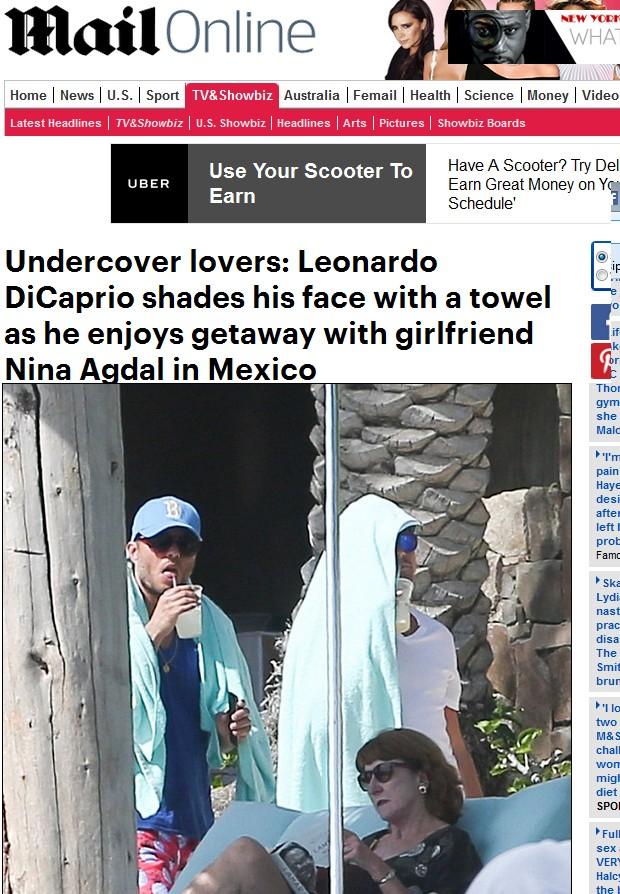 Leonardo DiCaprio cobre o rosto com toalha branca (Foto: Reprodução/Daily Mail)