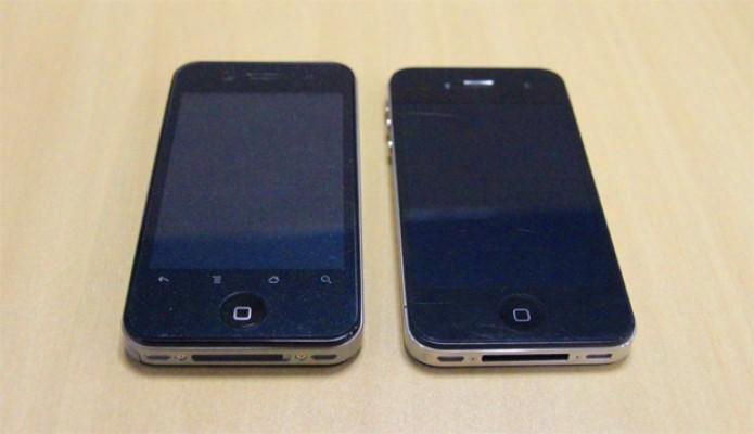 Hiphone e iPhone 4S lado a lado: aparelhos semelhantes no design, mas com especificações muito diferentes (Foto: Isadora Díaz/TechTudo)