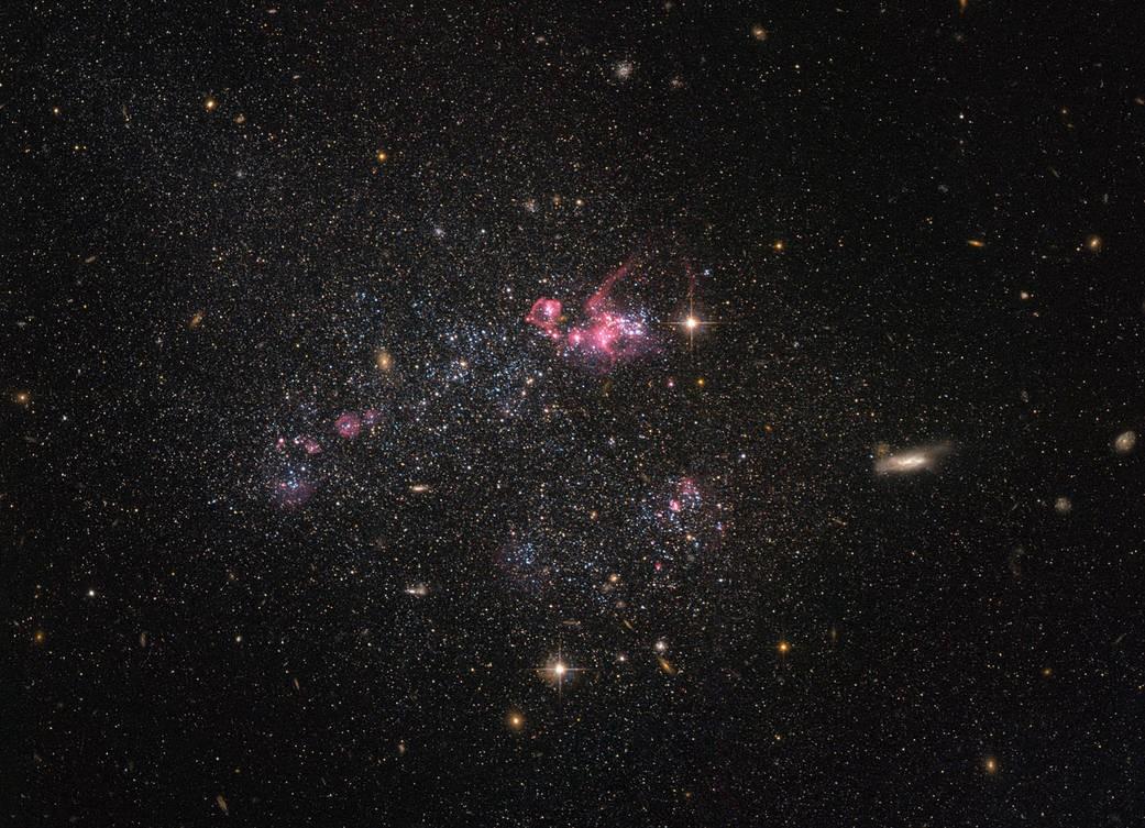 Fotografia do sistema UGC 4459 feita pelo Hubble (Foto: Divulgação/Nasa e ESA)