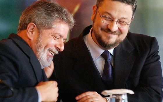 O ex-presidente Luiz Inácio Lula da Silva e o ex-ministro Antonio Palocci (Foto:  Adriano Machado/EFE)