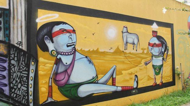 O grafiteiro Crânio homenageou os índios brasileiros nesta obra em muro da rua Paulo Gontijo de Carvalho (Foto: Charles Humpreys/BBC)