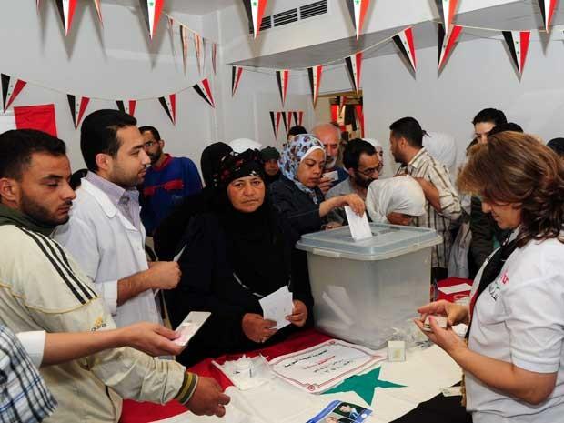 Posto de votação em Damasco. (Foto: Sana / AFP Photo)