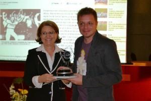 Maria Julita Volpato Gomes, diretora executiva da ACIC, e João Lucas Cardoso (Foto: ACIC/Divulgação)