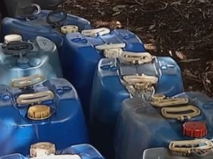 combustível foi apreendido em posto em Uberlândia (Foto: Reprodução/TV Integração)