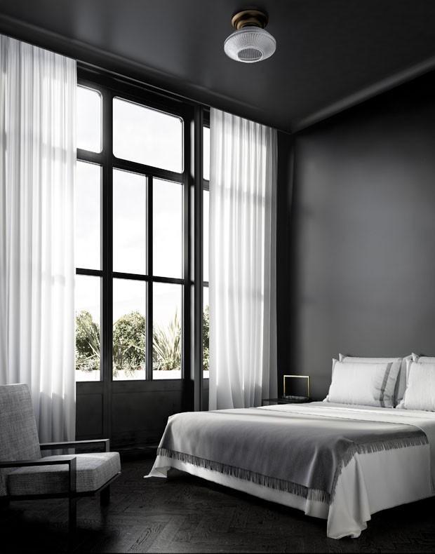 elegante e sóbrio linhas retilíneas marcam este quarto minimalista e