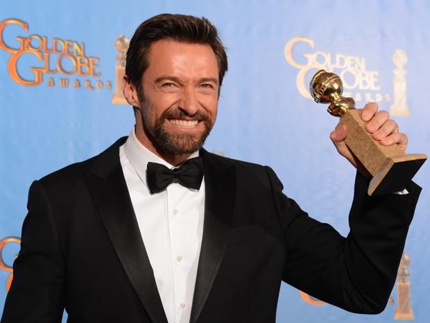 Hugh Jackman levou o Globo de Ouro de melhor ator em musical por 'Os miseráveis' (Foto: Robyn Beck/AFP)