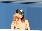 Heidi Klum faz topless em Miami