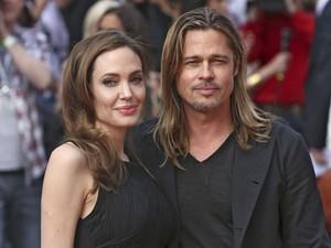 Angelina Jolie e Brad Pitt divulgam 'Guerra Mundial Z' em Londres neste domingo (2) (Foto: REUTERS/Neil Hall)