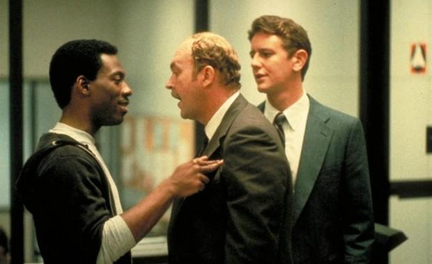 Eddie Murphy, Judge Reinhold e John Ashton em cena de 'Um tira da pesada', de 1984 (Foto: Reprodução)