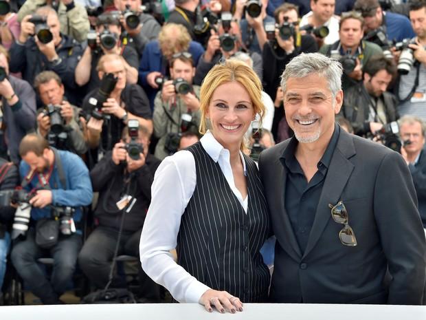 Julia Roberts e George Clooney divulgam 'Jogo do dinheiro' no Festival de Cannes (Foto: LOIC VENANCE/AFP)