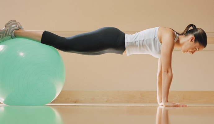 Mulher fazendo pilates euatleta (Foto: Getty Images)