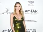 Veja o estilo de Heidi Klum, Charlize Theron e mais em evento beneficente