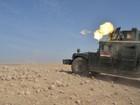 Iraque toma cidade próxima a Mosul; secretário dos EUA visita Bagdá