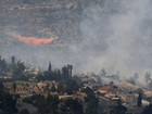 Incêndio obriga pessoas a deixarem assentamento em Israel às pressas