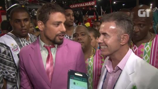 De terno rosa, Cauã tieta bambas e rejeita título de muso da Mangueira