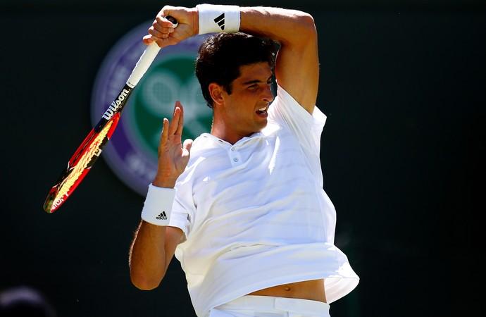 Thomaz Bellucci encara Rafael Nadal em Wimbledon (Foto: Getty Images/Julian Finney)
