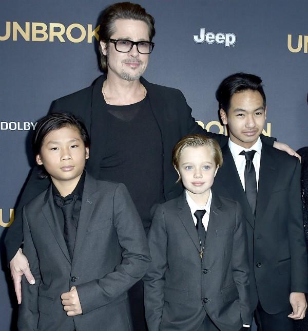 O ator Brad Pitt e três de seus seis filhos (Foto: Getty Images)