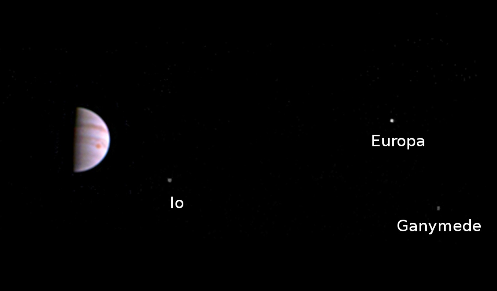 Imagem feita pela JunoCam mostra Júpiter e três das quatro luas do planeta