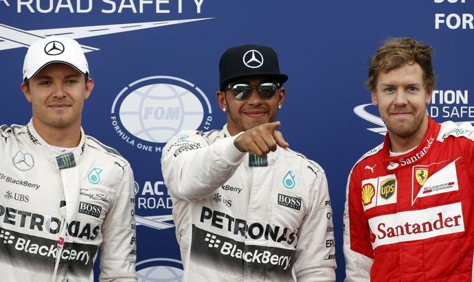 Lewis Hamilton, entre Nico Rosberg e Sebastian Vettel: os três primeiros do grid em Mônaco (Foto: AFP)