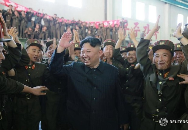 Líder norte-coreano Kim Jong-un reage após teste de míssil Hwasong-14  (Foto: KCNA/via Reuters)