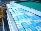 Polícia apreende 15 mil maços de cigarros dentro de mesa de sinuca