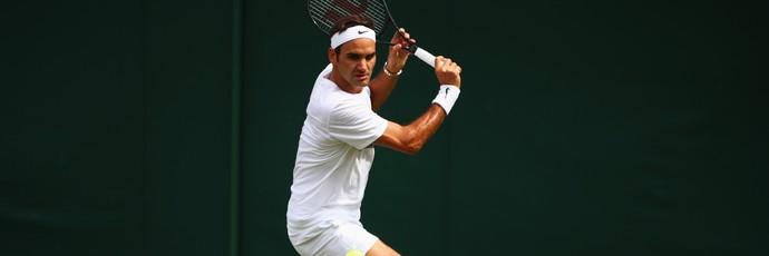 Roger Federer treinando para Wimbledon (Foto: CLIVE BRUNSKILL / GETTY IMAGES EUROPE / Getty Images/AFP)
