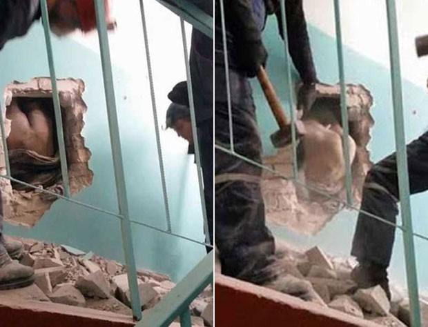 Bombeiros tiveram que quebrar a parede para conseguir retirar o homem (Foto: Reprodução/YouTube/White Owl)