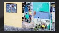 Fotógrafo capta momentos de torcida pelo Brasil no Complexo do Alemão