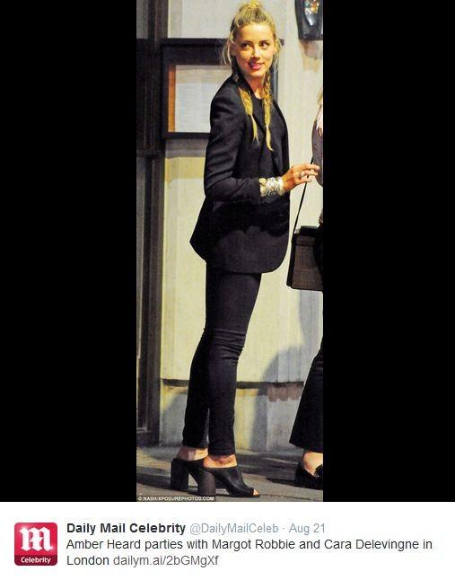 Clique de Amber Heard se divertindo em Londres no Tweet do Daily Mail (Foto: Reprodução/Twitter)