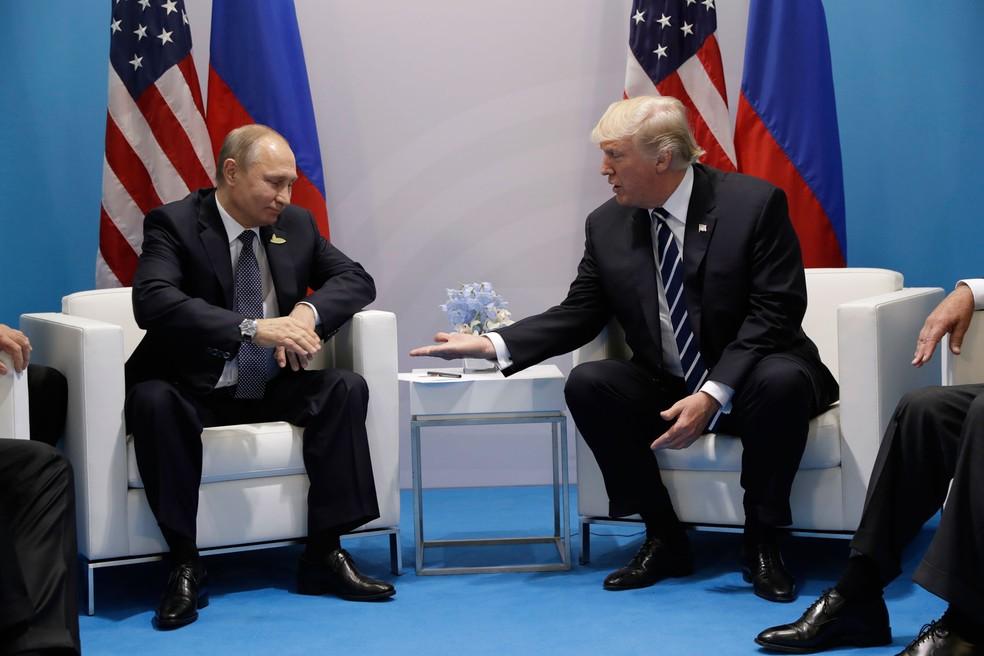 Presidente americano Donald Trump encontra presidente russo Vladimir Putin no G20  (Foto: AP Photo/Evan Vucci)