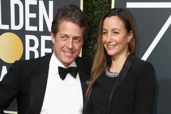 O ator Hugh Grant e a produtora Anna Eberstein (Foto: Getty Images)