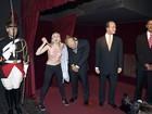 Ativista que fez topless é multada por ataque a boneco de cera de Putin
