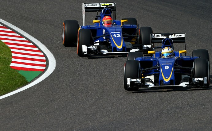 Felipe Nasr e Marcus Ericsson no GP do Japão de 2015 (Foto: Getty Images)