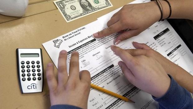 criança; poupança; dinheiro; educação financeira; (Foto: Scott Eells/Getty Images)