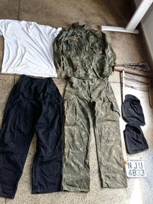 Roupas pretas e camufladas foram apreendidas na Operação Mercenários (Foto: Assessoria/Polícia Civil de MT)