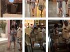 Glória Pires anda pelo shopping  sem desgrudar de seu iPad