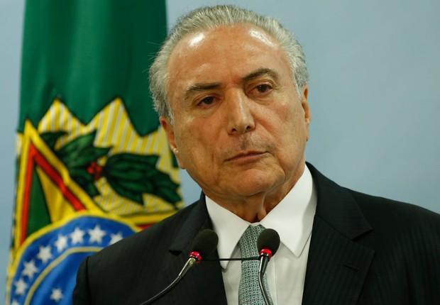 O presidente Michel Temer em pronunciamento no Planalto (Foto: Igo Estrela/Getty Images)
